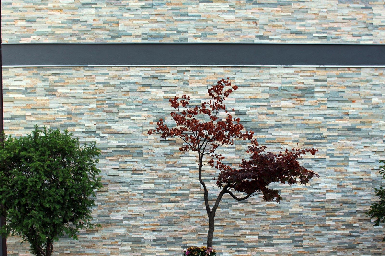 [49] Una facciata frammentata - abitazioni, rivestimenti a basso spessore preassemblati